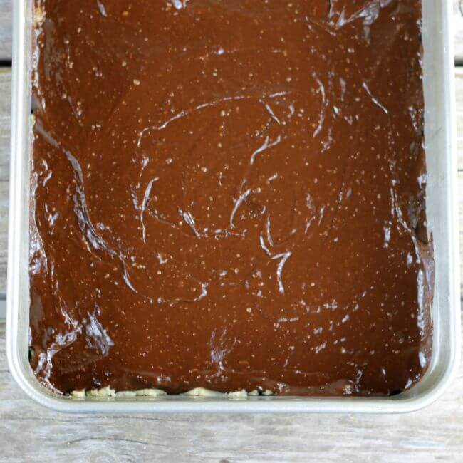 The chocolate mixture is spread over the top of the crust.