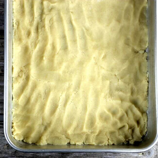 The crust is pressed into the bottom of the baking pan.