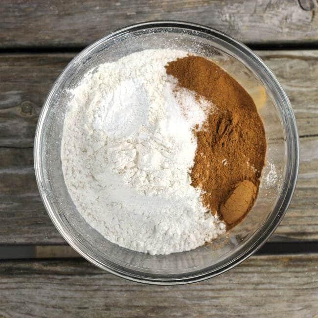 Flour, salt, and cinnamon in a glass bowl.