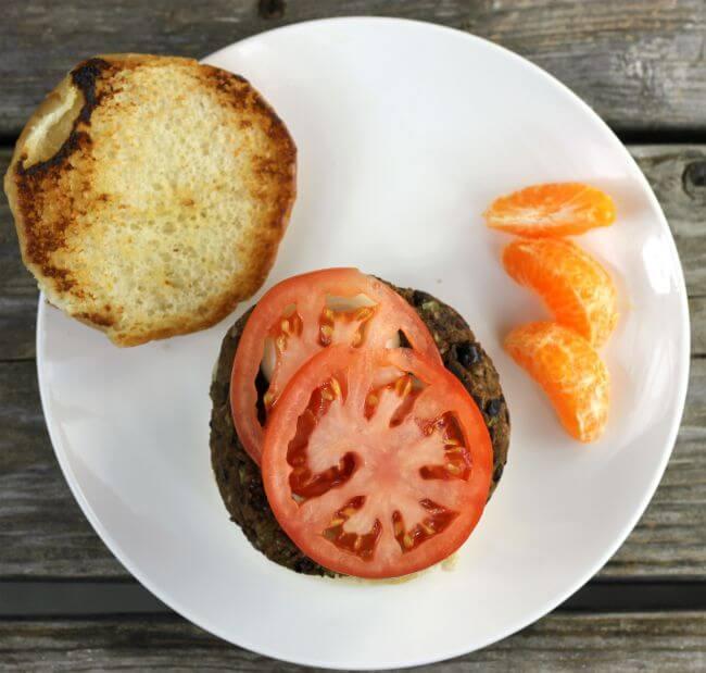 Black bean burger on a bun with a tomato.