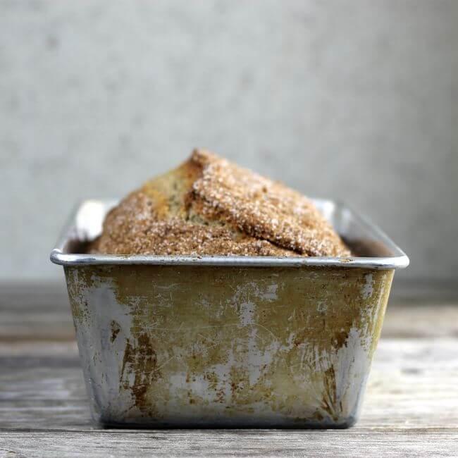 Side view of bread in a bread pan.