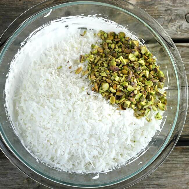 Coconut and pistachios added to the egg whites.