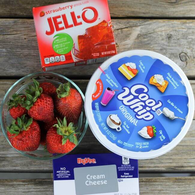Cool whip, cream cheese, box of Jell-O, and strawberries.