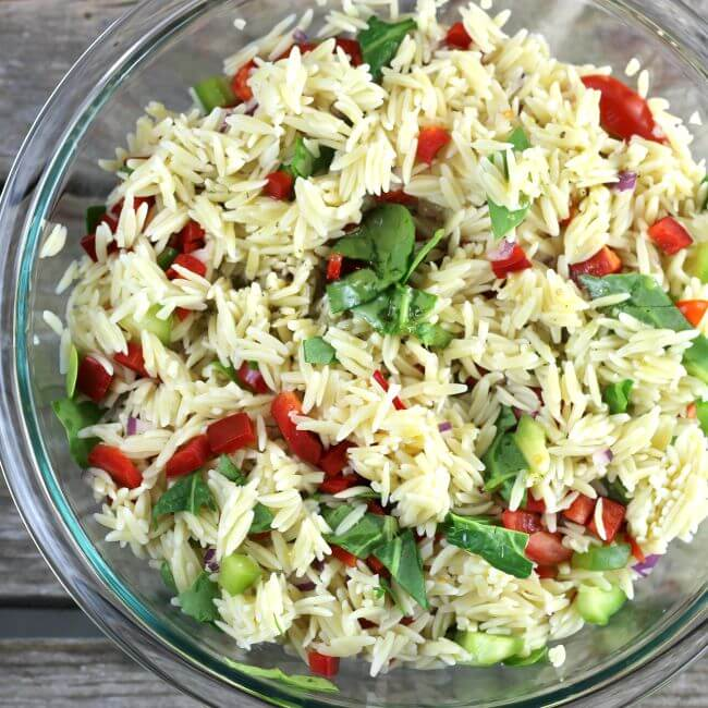 Orzo salad with the dressing ready to toss in.