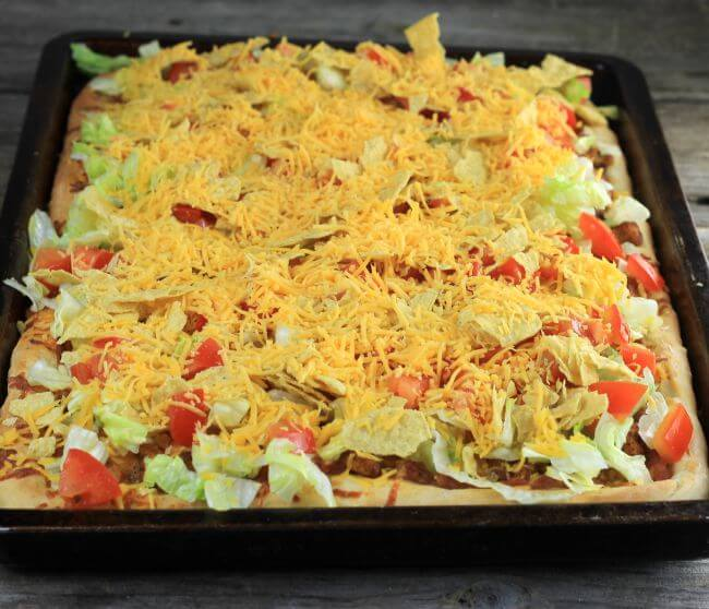 Chicken taco pizza in a jelly roll pan.