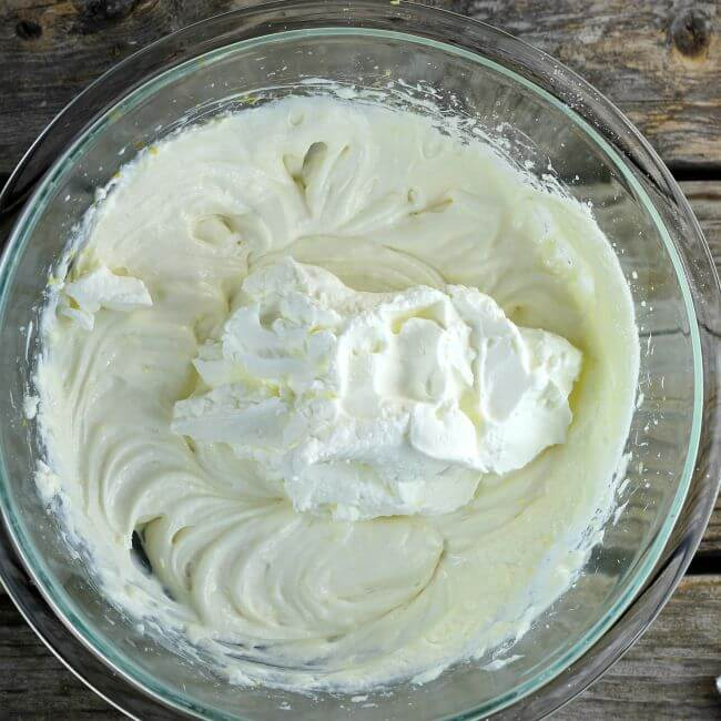 Add the whipped cream to the cream cheese mixture.