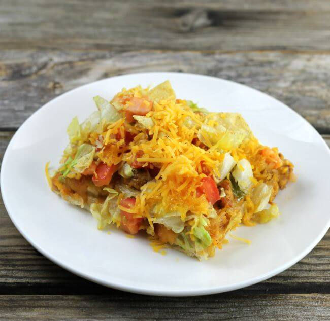Side angle view of chicken taco pizza.