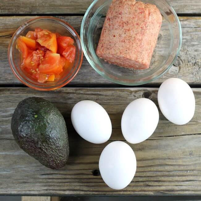 Tomato, sausage, avocado, and eggs.