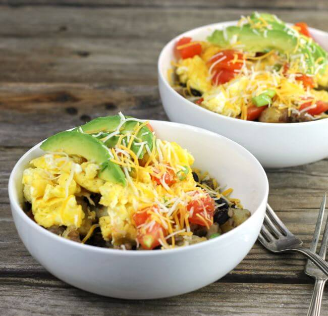 Two bowls of southwest breakfast bowls.