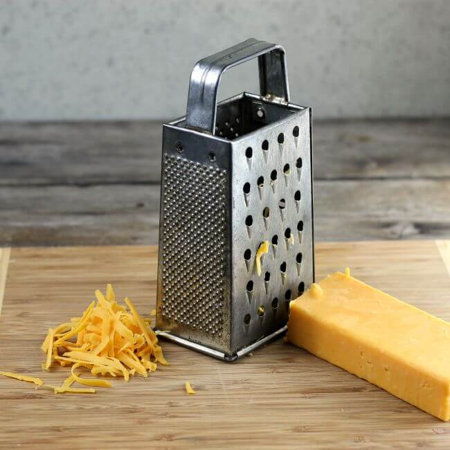 Shredding cheese with a box grater.