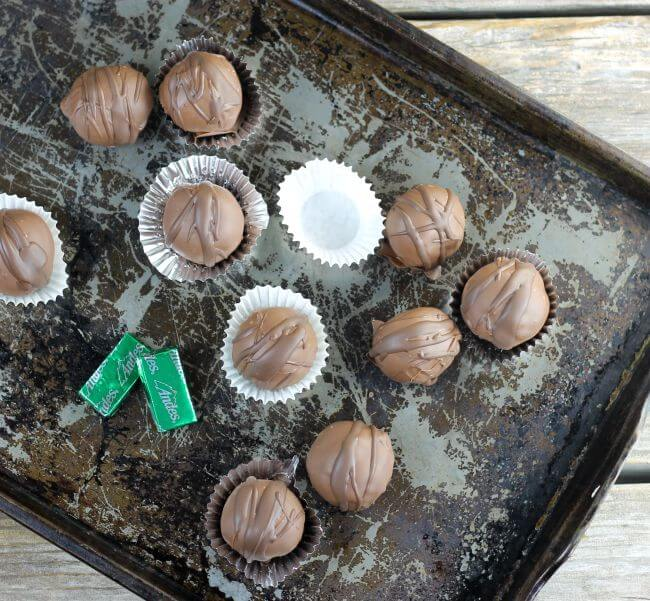 Looking down at mint brownie truffles on an old baking pan.