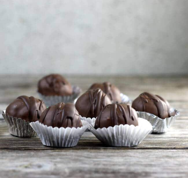 Side view of mint brownie truffles on a table.