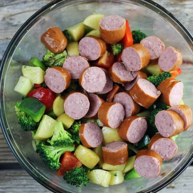 Smoked sausage is added to the vegetables.