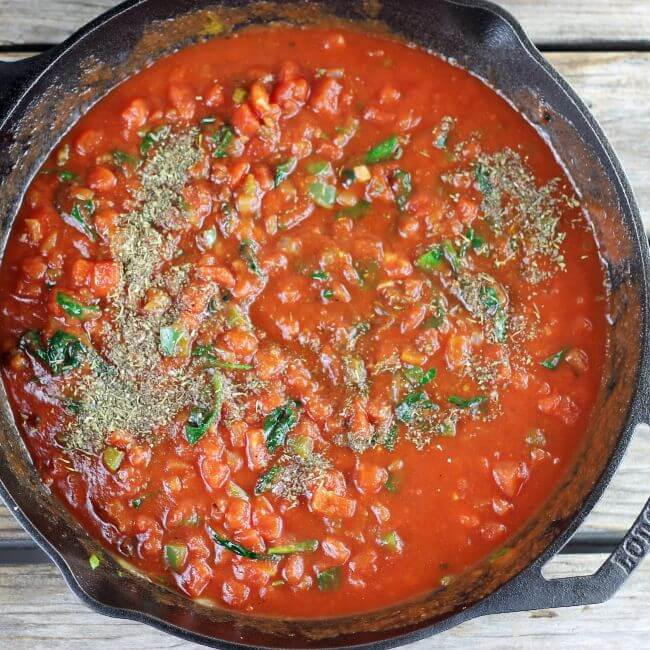 Italian seasoning is added to the sauce.