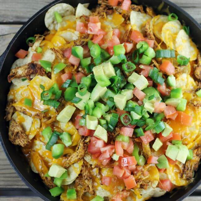 Topping are added to the nachos.