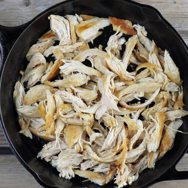 Shredded chicken in a skillet.